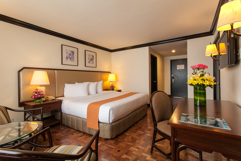 Deluxe Room With Two Double Beds And Balcony