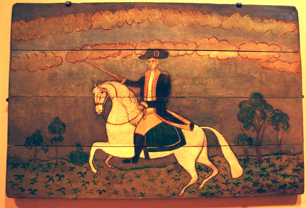 General George Washington Riding A White Horse Holding A