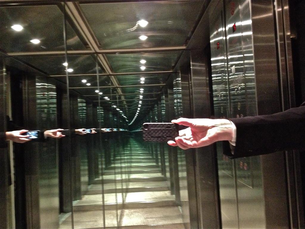 Recursive mirror effect in hotel elevator wolfkann flickr for Double mirror effect