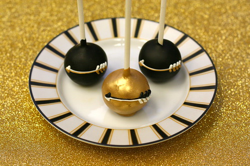 Gold and Black Arrow Themed Cake Pops | by Sweet Lauren Cakes