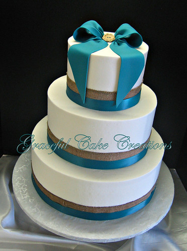 A Simple White Wedding Cake with Burlap and Teal Blue Ribb ...