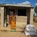 Sheckster Mangwanga outside her shop in Kalomo District