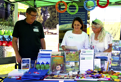 Rural Development State Director Vicki Walker staffing the USDA booth at the Eugene/Springfield Pride Festival