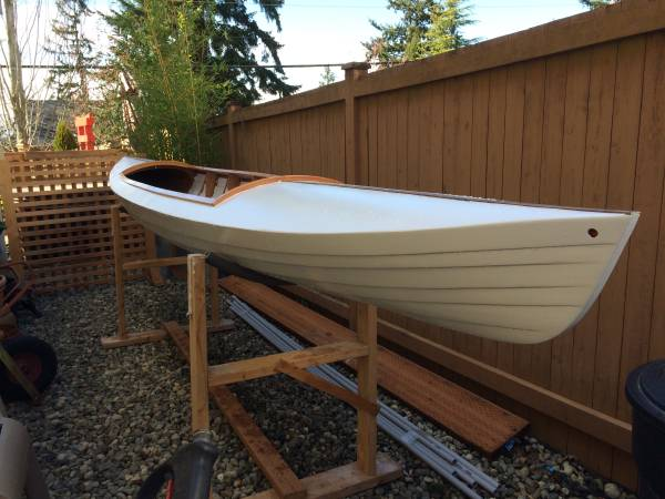 Trying to identify a lapstrake kayak or decked canoe