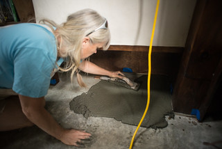 Liz Applying First Layer of Earthen Floor | by goingslowly