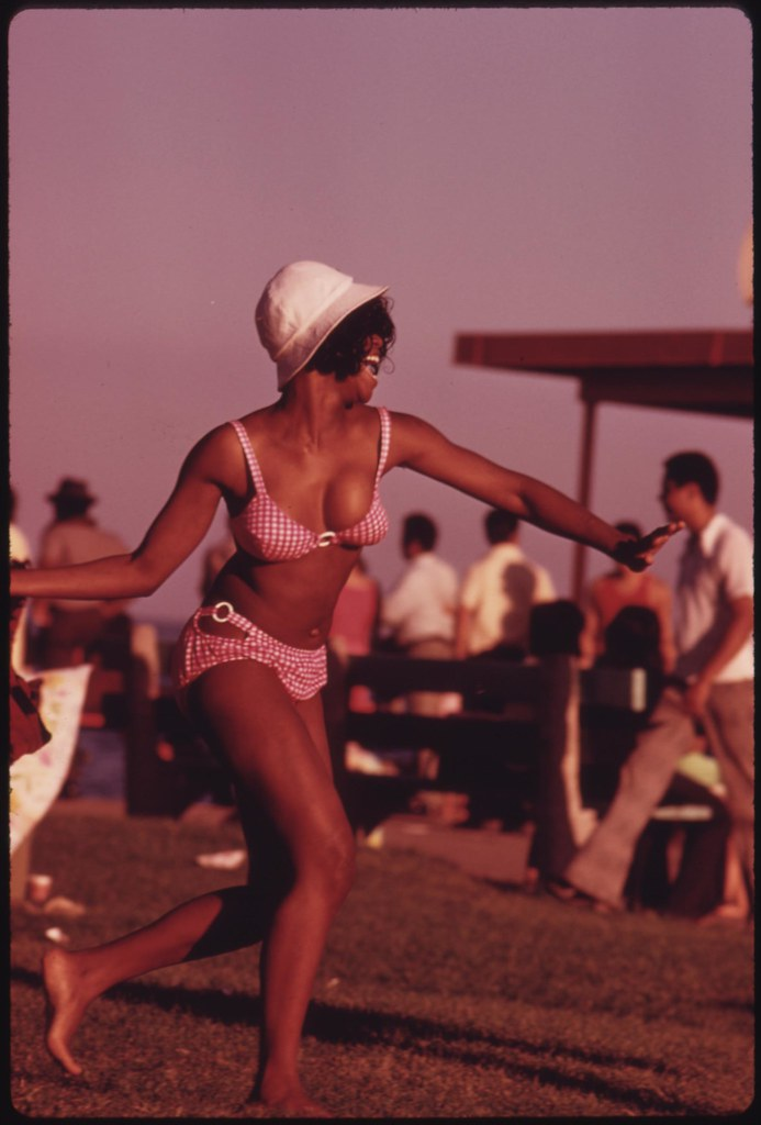 A Swimsuit Clad Black Woman Enjoys Her Summer Outing At Ch
