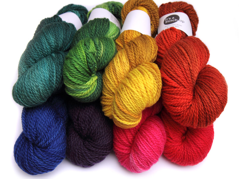 Awesome Aran semi-solid shades (clockwise from top left): Heart of Glass, Suffragette Green, Corn on the Cob, Foxy, Cheated Hearts, Pink Sunshine, Dark Purple, Electric Blue