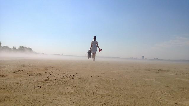 woman walking dress sand sky