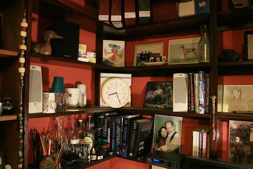Intimate Corner Shelves over Desk