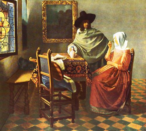 """Der Wein in Kunst und Literatur. Das Gemälde: """"Herr und Dame beim Wein"""" von Jan Vermeer van Delft (1632 - 1675). Sitzendes junges Mädchen in rotem Kleid beim Weintrinken. Ein daneben stehender Mann mit Weinkrug, der selbst kein Glas hat. Gleich wird er wieder nachschenken. Ist es eine Weinprobe - oder hat der Herr zweifelhafte Absichten? Zu sehen ist das Ölgemälde in der Gemäldegalerie Berlin."""