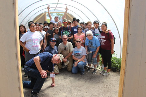 NACR&DC members posing with Reno-Sparks Indian Colony teens in hoop house
