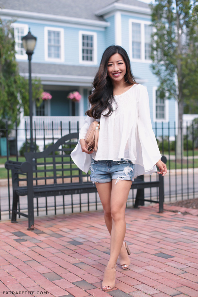 Flowy white top denim shorts summer outfit_extra petite