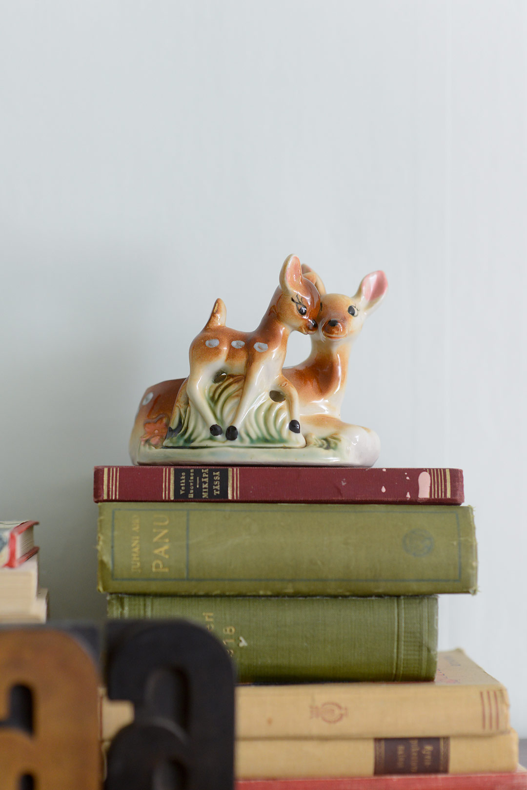 Vintage porcelain deer and vintage books
