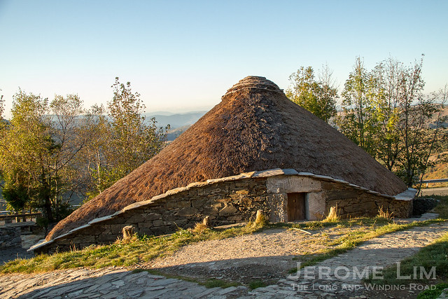 A traditional thatched roof stone hut known as a palloza at O'Cebreiro.
