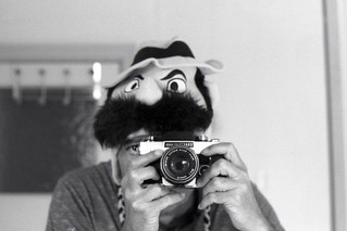 reflected self-portrait with Exakta RTL1000 camera and moustachioed hat