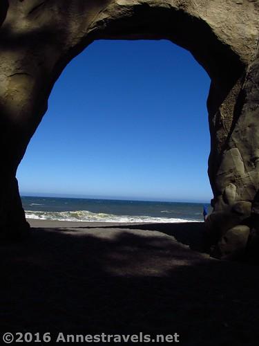 Looking through Floras Lake Beach Arch, Oregon