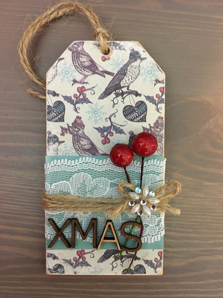 Wooden tag decoupaged with Craft Consortium Christmas paper by StickerKitten