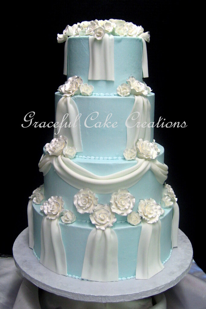 Elegant Light Blue Butter Cream Wedding Cake With White Fondant Swags And Sugar Paste Roses