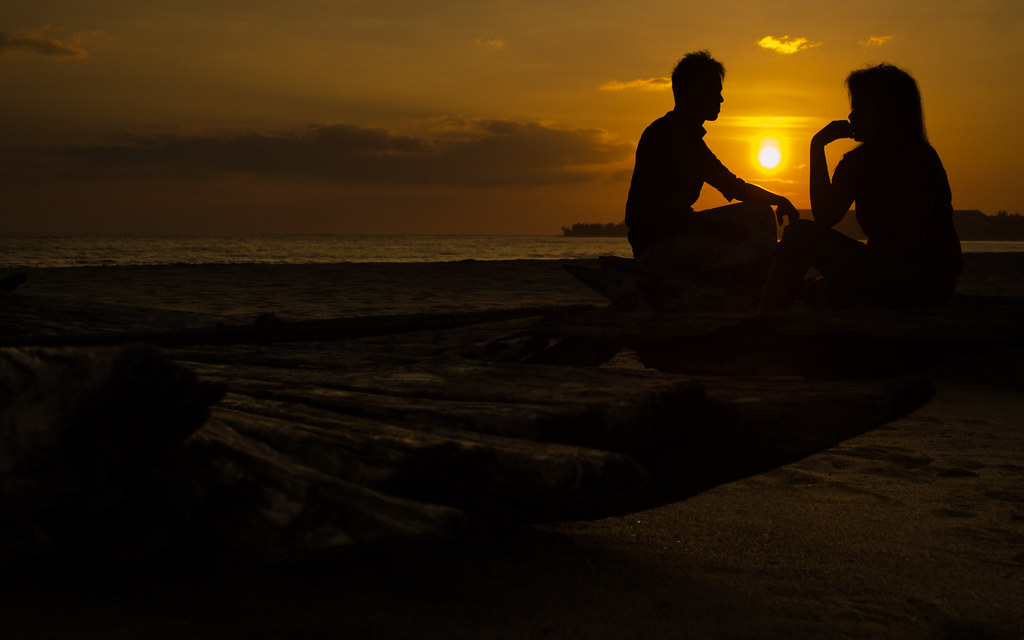 love and sunrise, a couple in beach.