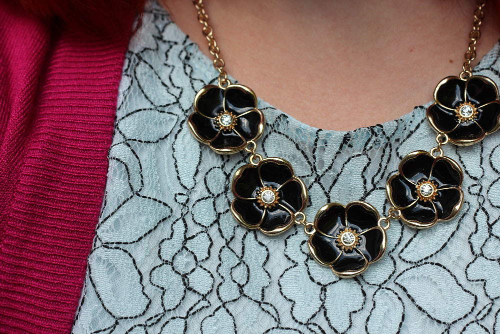 Black and Gold Flower Necklace on Light Blue Lace
