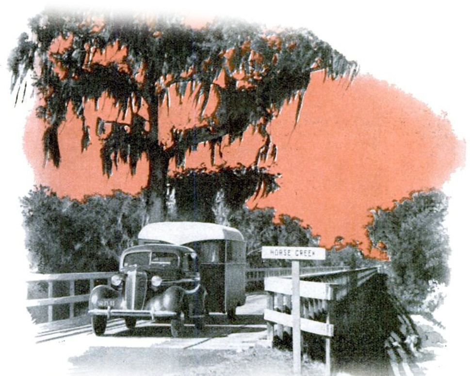 The author's caravan in a typical southern setting. Miles of scenery like this roll pas the windows of the trailer. - Popular Science, April 1937