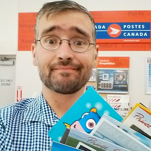 Me with the postcards #me #selfie #pei #charlottetown #postcard #postcards