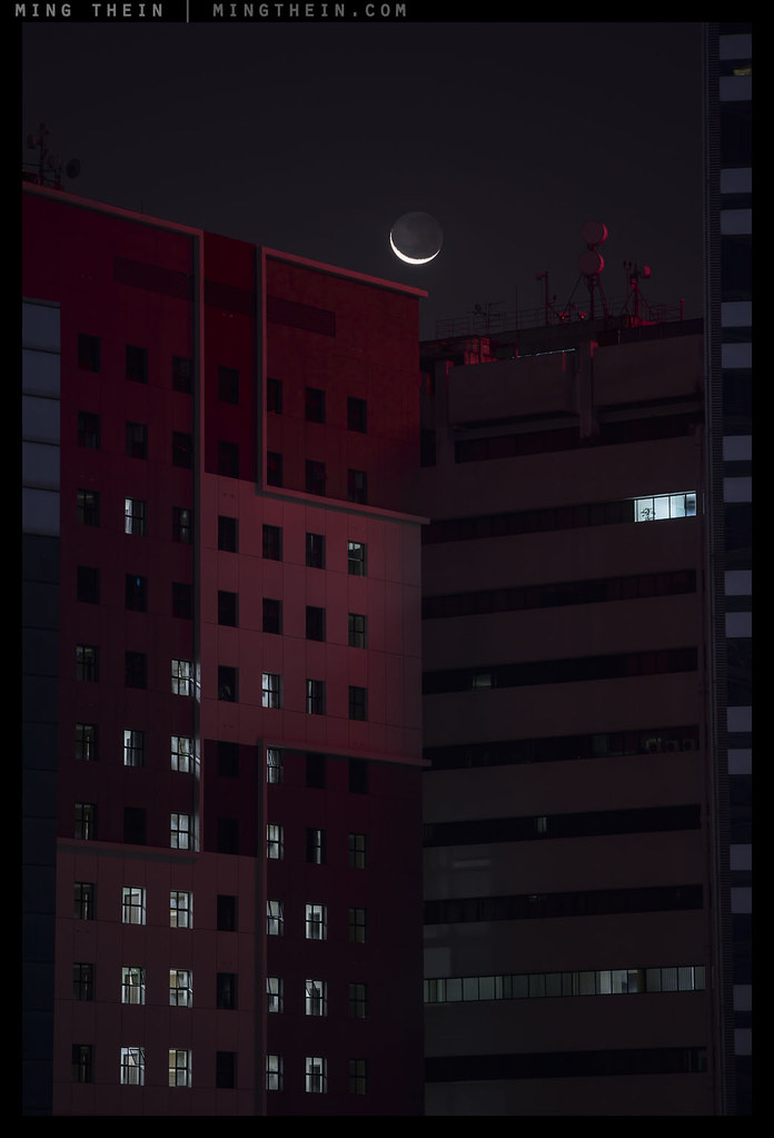 Crescent moon, red building by Ming Thein