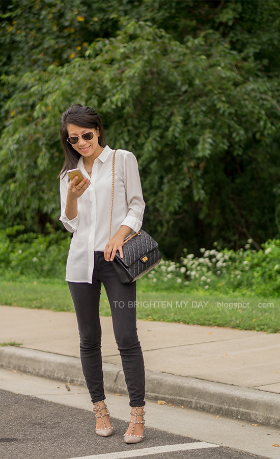 white silk boyfriend shirt, gold jewelry, black jeans, black shoulder bag, nude studded heels