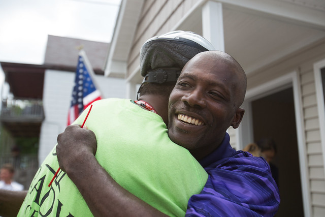 Dolphus Johnson embraces a friend after cutting the ribbon on his new tiny home at the ribbon-cutting ceremony of A Tiny Home for Good's first two-unit property. Johnson will be one of the new veteran residents and is looking forward to having a space all his own. | Dominique Hildebrand