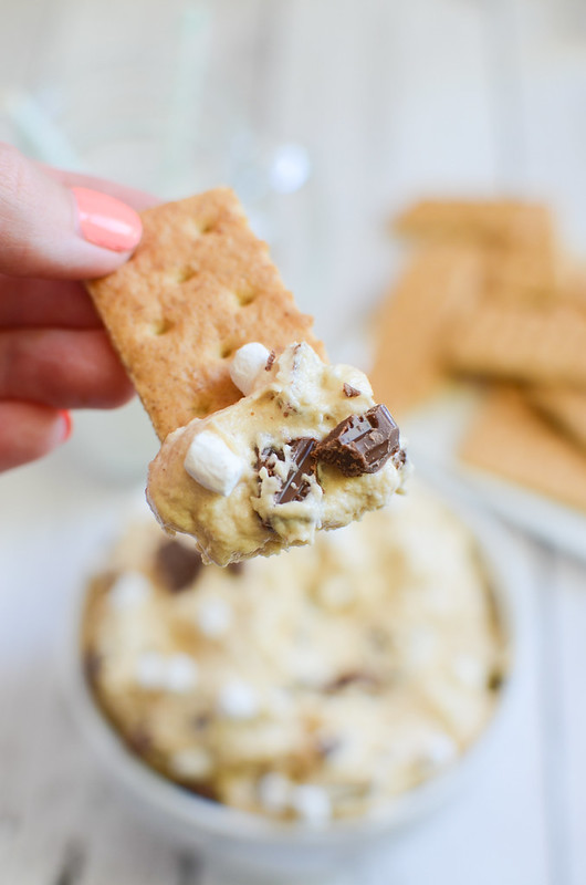 Peanut Butter S'mores Dip - the most delicious dessert dip! Peanut butter with chocolate and marshmallows! Serve with graham crackers for the ultimate s'mores experience!