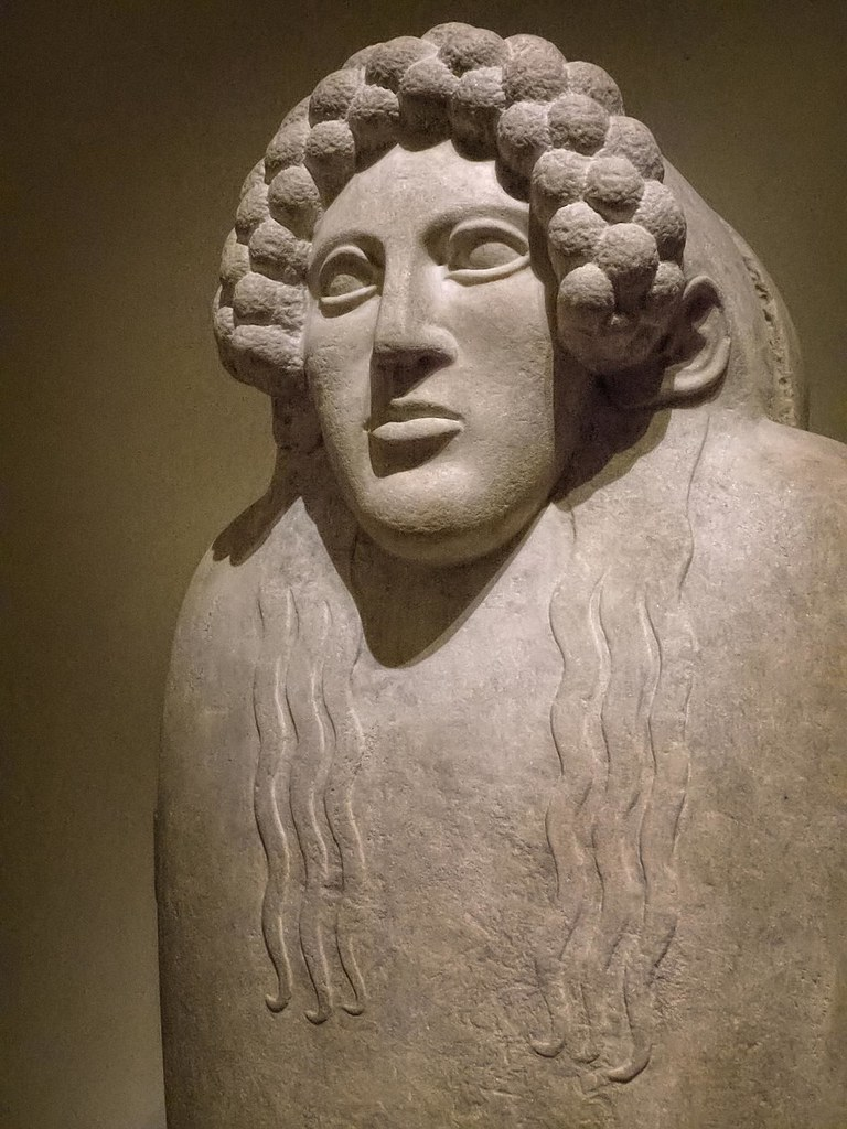 Closeup Of The Female Face On The Marble Anthropoid Sarcop
