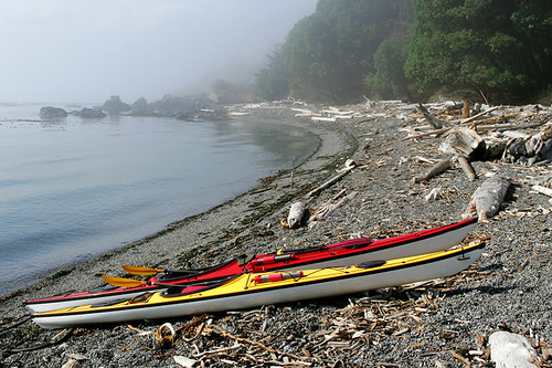 Sea kayaks on a remote beach on Vancouver Island, British Columbia, Canada. | by BCVacation