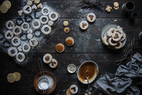 rosemary-hazelnut linzer cookies with salted caramel filling. | by Two Red Bowls