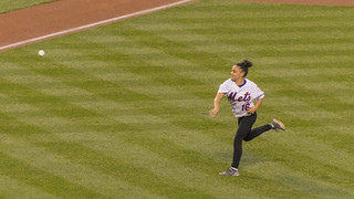laurie hernandez throws the first pitch at citi field in n flickr