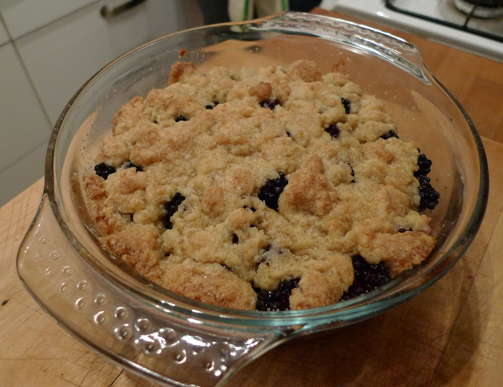 Apple and blackberry crumble in dish