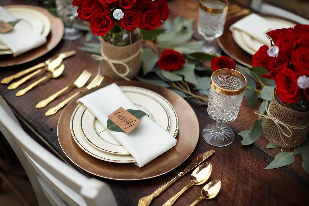Place Setting For The Bachelor Viewing Party With A Rustic Theme Red Roses In Glass