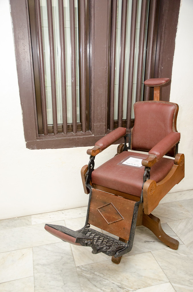 A vintage barber chair in Hotel Puri Melaka