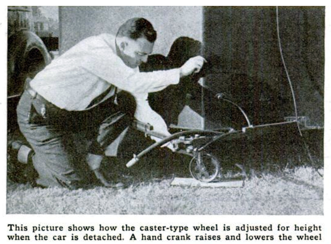 Adjusting the height of the tongue wheel of a camping trailer. A hand crank raises and lowers the wheel. Popular Science April 1937.