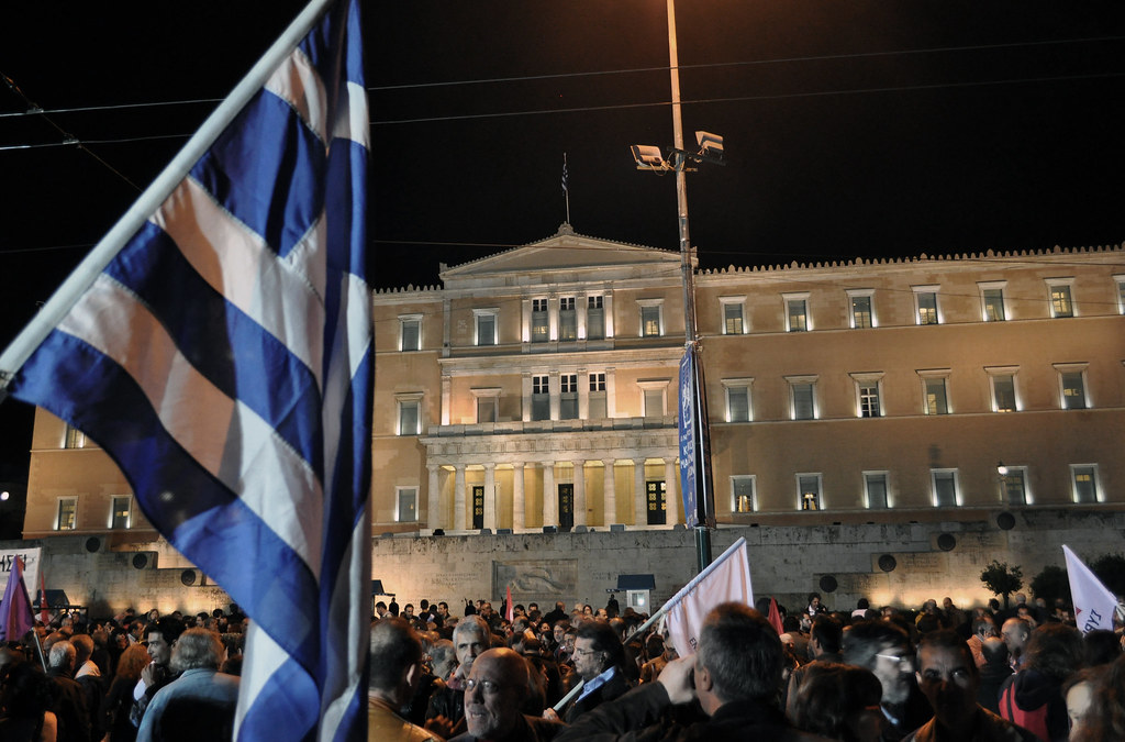 Syriza Protest 1 Greek Flag |  Athanasios Lazarou CC BY 2.0
