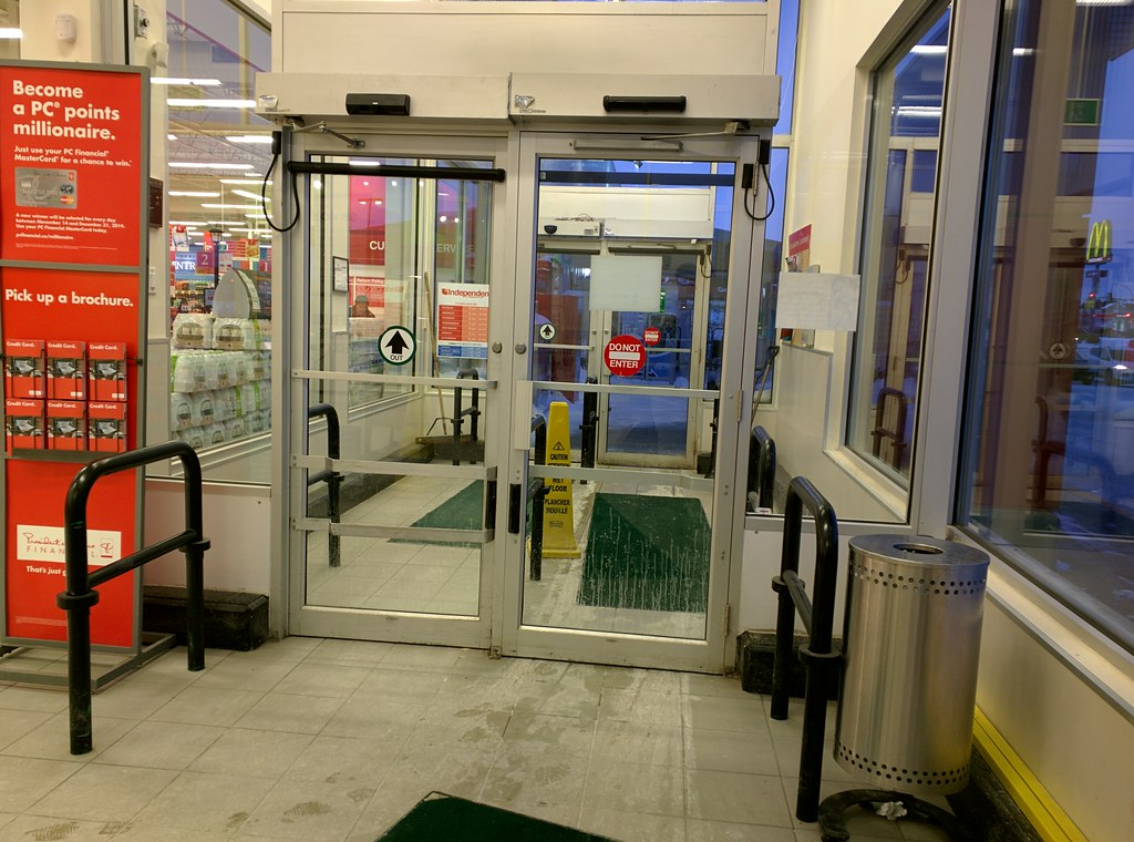 Old Decals On Automatic Doors At Your Independent Grocer