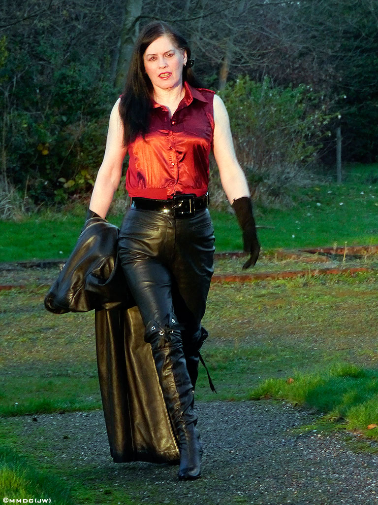 Mistress in red thigh high boots fucks a guy with strapon 7