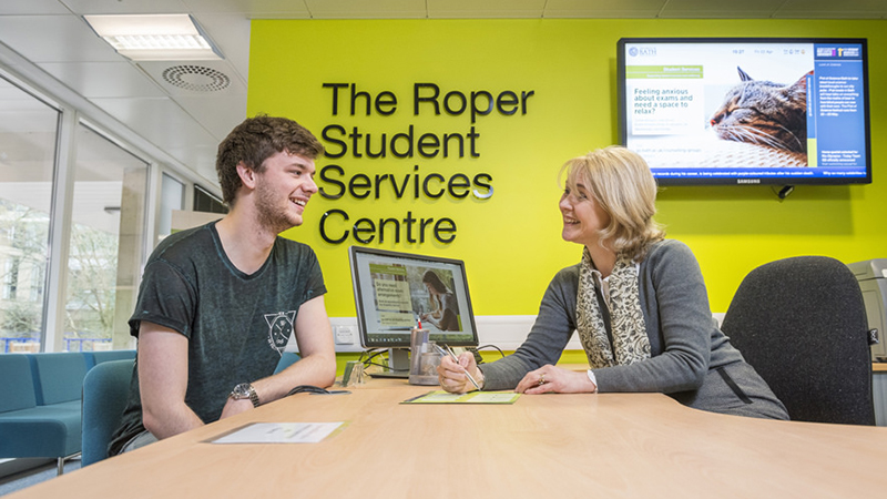 A student visits the Student Services reception desk