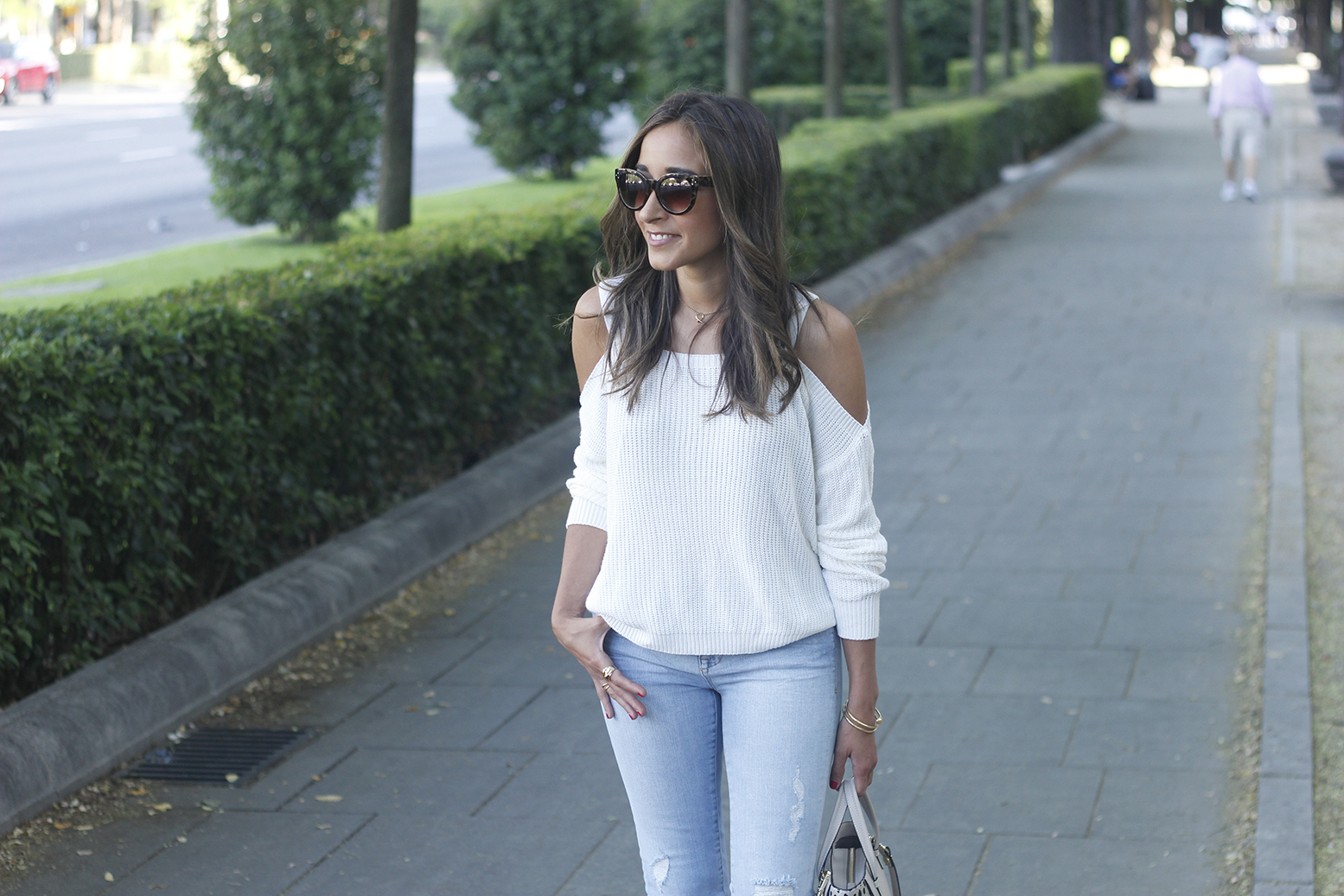 White off the shoulder sweater jeans acosta bag heels outfit style10