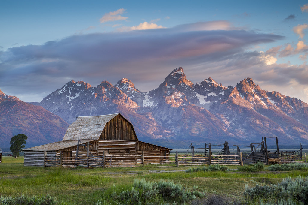 Barn At Mormon Row With Grand Teton As Background Sunris