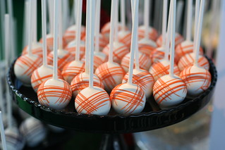 Orange and black styled cake pops | by Sweet Lauren Cakes