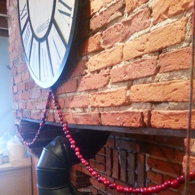 A .99 bag of cranberries for the eight year old, needle and embroidery floss made a cheery strand above the coal stove.
