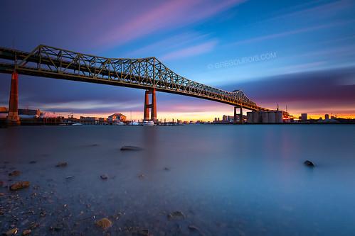 Tobin Bridge Spans Mystic River Into Boston In Golden Ligh
