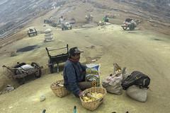 Miner breaking sulphur in smaller pieces - Ijen East Java