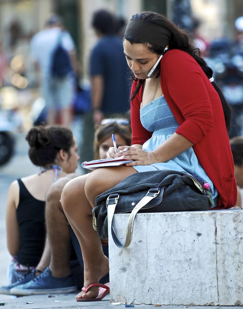 a candid girl multitasking | largo camões, lisbon, portugal | flickr