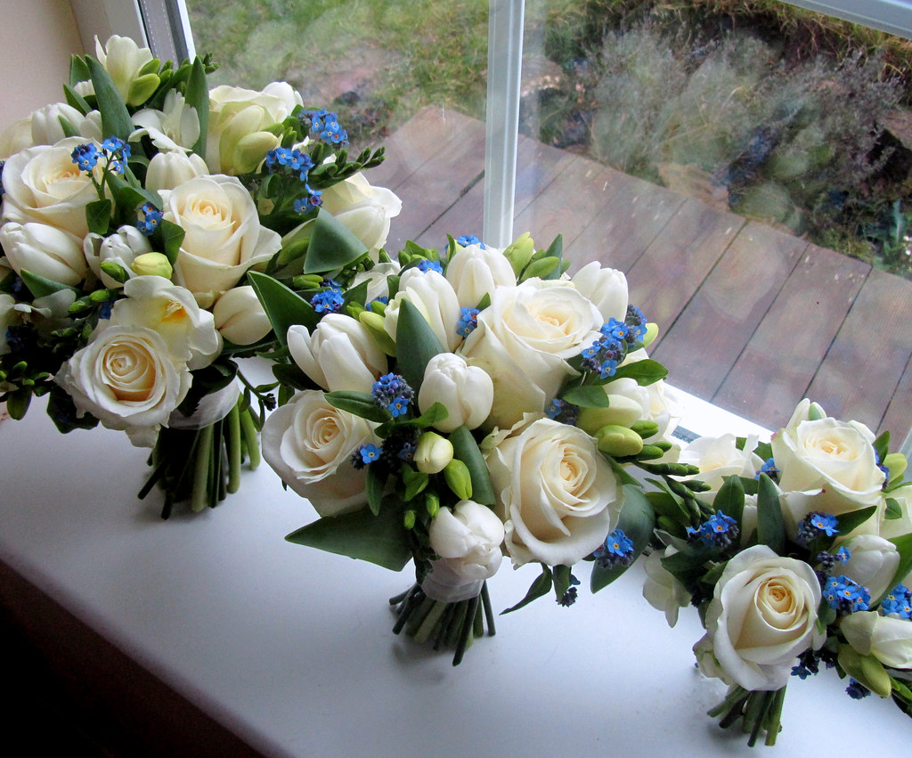 Blue and white bouquets bouquet of white roses tulips and flickr blue and white bouquets by the flowersmiths wedding flowers izmirmasajfo
